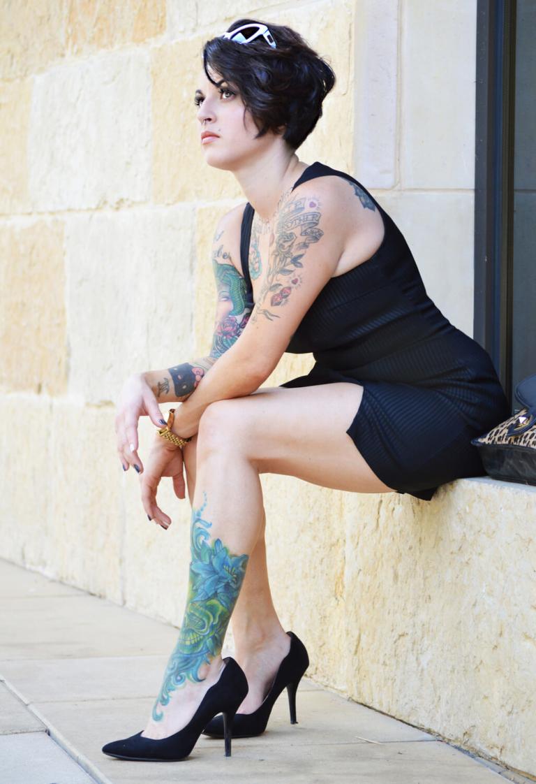 Tattooed model in a short dress, Austin Texas