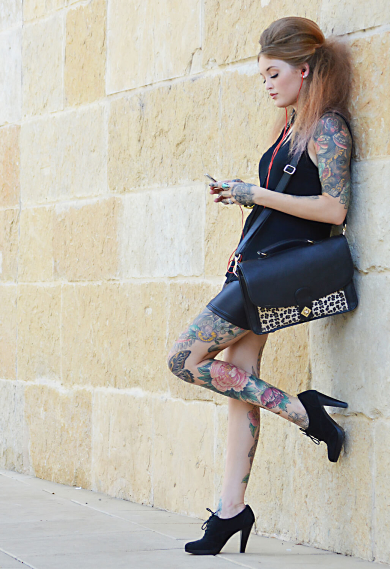 Tattooed model with cell phone, Austin Texas